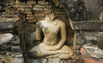 Headless Buddha statue.
